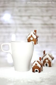 Mini gingerbread houses for hot chocolate or coffee.