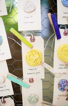 fabric rosette escort cards with fabric clothespins on chicken wire