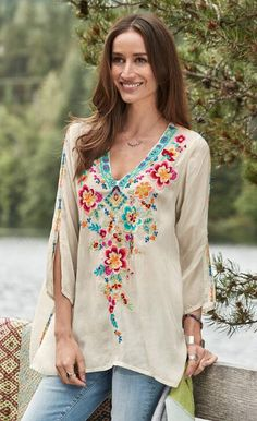An abundance of eye-catching details elevates our 'Leilani' embroidered V-neck top.