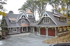 Love these arch supports . Add one over garage, over A- frame in front. repeat arch in garage door and across front porch.
