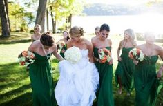 Long Dark green bridesmaids dresses with bride - not the style of dress but for color and sense of cohesion. peach floral to complement rose gold accessories possibly and brighten up for summer