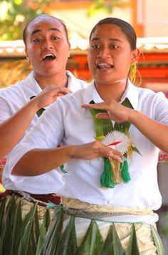 Ladies performing a Tautonga