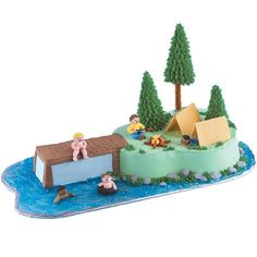 Park Paradise Cake - Fun nature details really make this cake work for kids. Easy add-ons like pretzel rod trees, a mini pretzel campfire and piping gel lake add a touch of the great outdoors.