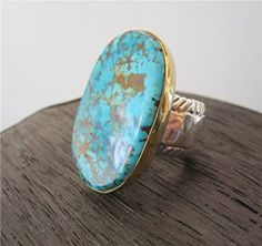 Turquoise Ring by Vedeli Designs. All natural, American, Blue Oasis Turquoise with a 22k gold bezel and a sterling silver ring.