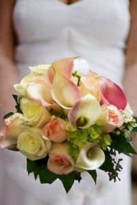 vintage inspired wedding bouquet. this wedding bouquet has  beautiful blooms  in pinks whites and greens including roses, calla lilies and hydrangeas. Jumping for Joy by Enchanted Florist in Taos, New Mexico. http://www.taosflorist.com/weddings/taos-wedding-flowers/