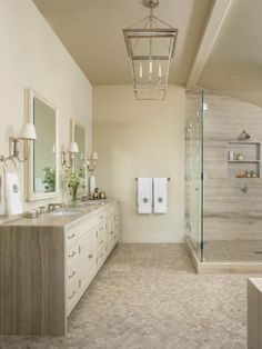 Neutral Spa Bathroom With Mosaic Tile Floor