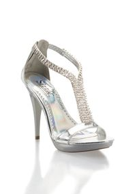 """Sparkle like the """"Biggest Little City"""" in these platform t-strap sandals. Eight dazzling rhinestone strips divide to form the """"T"""" and wrap the ankle to the closed back heel. A zipper closure makes for a quick on and off. 4 3/4"""" heel with a 1"""" platform. Manmade sole and upper. Imported. Sizzle by Coloriffics."""