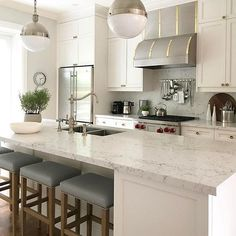 We're star struck by this beautiful kitchen featuring our new color White Attica. Design by Allison Willson. ・・・ Our clients custom kitchen is complete! We had a custom hood made and mixed our metals throughout to get a more layered look.