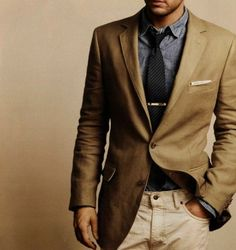 simple yet chic men's style: denim shirt, taupe jacket, tan slacks and a casual tie
