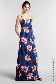 A printed sleeveless maxi dress makes a statement worth remembering. With its relaxed fit, delicate straps and bold blue and pink floral print, you can keep the accessories minimal and pair with either flat shoes or sandals. Shop now at Banana Republic.