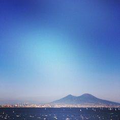 Mt. Vesuvius looms over the Naples' skyline. Photo courtesy of sightceers on Instagram.