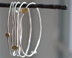 simple and pretty...: ardent sterling bangles ~ Kathi Roussel  Would need a few to create this look well