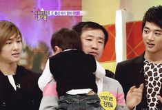 I don't know what's cuter the baby or onew reaction to the baby