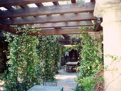 Fragrant Climbing Vine Covers Wooden Pergola  Wide timbers were used to build this pergola that hangs over a large terraced area. It hangs full of fragrant jasmine vine, creating an outdoor room to enjoy. Pergola Plans and Gazebo Design Ideas | HGTV