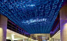 Blue Stratus, a luminous ceiling installation at a new shuttle station serving the Phoenix Sky Harbor International Airport, was designed by Mario Madayag, Michael Parekowhai, and Paul Deeb.