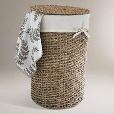 Trista Seagrass Round Hamper - World Market by Cost Plus World Market. $39.99. Our striking Trista Seagrass Round Hamper is handwoven with natural seagrass twisted and woven around a metal frame. Its handy lid keeps your dirty laundry out of view and the cut out handles make it easy to tote your wash to the laundry on cleanup day. We know you'll enjoy how easy the machine washable, 100% cotton liner is a snap to remove and clean.