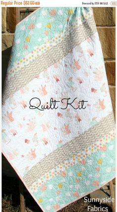 ❘❘❙❙❚❚ ON SALE ❚❚❙❙❘❘     This listing is for a Quilt Kit featuring The Littlest for Art Gallery Fabrics. Quilt will measure approximately 39 x 49 Kit includes:  Simple Instructions * 19.5 inches Bunnies on White focal print * 18 inches Tulips on Mint for top and bottom stripes * 5 inches Dots for small sashing * 9 inches Gray Ribbon for large sashing * 13 inches for binding * 55 inches for backing  You can purchase the finished quilt here…