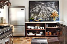 Ellen Pompeo's kitchen. Terracotta floors are from France. I like the different textures she uses.