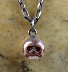 READY TO SHIP  Hand Carved Pink Pearl Skull on by ArloEdgeWalker