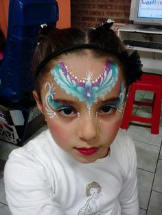 this cutie is clearly thrilled with her face paint, hahaha!