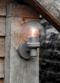 The unique shape of the Aldgate Outdoor Wall Lamp comes with a built in PIR sensor