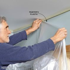 If you're painting spray texturing a ceiling, draping lightweight plastic sheetingis the best way to protect your walls. Here's a quick and easyway to hang the plastic. Use 1-1/2-in.-wide painter's tape with medium to high holding strength. Press the top edge down, but leave the bottom loose. It should curl up slightly to expose the sticky underside. Stick the edge of the lightweight plastic sheeting to the tape and let it hang to the floor. You don't need to tuck the plastic underneath the…