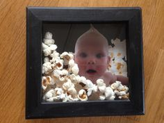 'Pop-up baby' - pictureframe with cardboard from a popcorn box, baby photo and real popcorn.