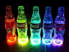 Cut a glow stick and pour it in to the coke bottle then shake it! And bam glow in the dark coke bottle! :O(Coke Bottle Lights)