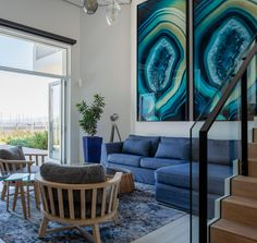 Previously an atrium, this downstairs sitting room spills out onto a wooden deck with views of the Gordon's Bay harbour. Wooden Decks, Atrium, Projects, Room, Log Projects, Bedroom, Blue Prints, Wood Decks, Rooms