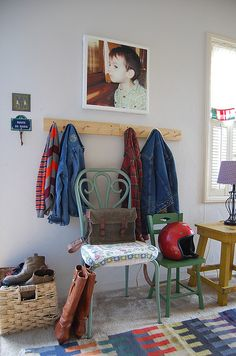 entry way.  colorful picture, coat hooks and maybe a few funky chairs with basket next to them instead of a bench…hmm