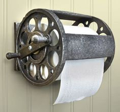 A unique industrial toilet paper holder! This wall-mounted fishing reel toilet paper holder is made of polyresin stone and measures W x H x D. It holds a double or standard roll of toilet paper. Such a wonderful addition t