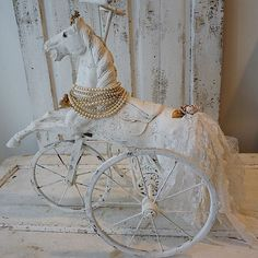 Shabby wooden horse statue large French Nordic white distressed metal wheels cottage chic carved ornate figure home decor anita spero design