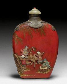 A FINE RED PAINTED WOOD SNUFF BOTTLE WITH STONE INLAYS. China, height 8.7 cm. Qianlong mark at the base. Matching stopper. Simply stunning