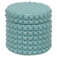 Brimming with eye-catching style, this ceramic jar showcases a faceted motif and blue finish.