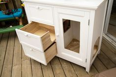 Small Potatoes for Childhood 101 - small chicken coop ideas. This is the coolest upcycle ever. Cabinet into chicken coop, must look at all the pics in post!