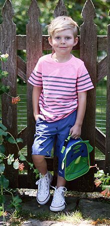 A striped tee, comfortable shorts, Converse sneakers, and a fun dinosaur lunch bag make for the perfect first day of school outfit.