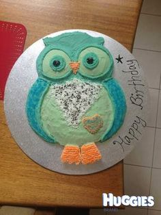 Owl design using 4 vanilla cakes and butter cream icing. Huge cake! Huge hit! First attempt at children's cakes.