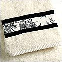 Embellish cheapo towels.  The pic shows fancy toile, but it can be any fabric... Kid's bathroom idea!