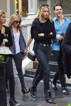 Gigi Hadid wearing Chanel Wallet on a Chain and Diesel Black Gold 25mm Metal Toe Leather Boots