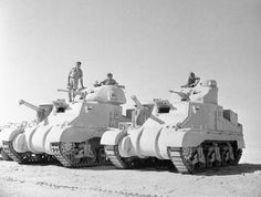 British M3 Grant (left) and Lee (right) in the Western Desert, 1942, showing differences between the British turret and the original design. Grant and Lee tanks of 'C' Squadron, 4th (Queen's Own) Hussars, 2nd Armoured Brigade, El Alamein position, Egypt, 7 July 1942. Photographer: No 1 Army Film & Photographic Unit