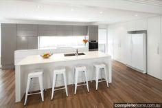 Designline kitchens - Sleek modern kitchen with a white kitchen island