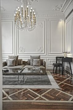 oooh this is just fabulous.  Living Rooms to Luxuriate In: on the grey sofa under the chandelier.