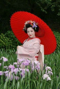 Geisha with a Japanese umbrella.