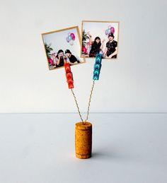 Make your own photo clips using dyed corks Upcycle your wine corks into these colorful photo holder