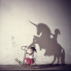 """I HAVE A DREAM •Apps used: ArtStudio, Snapseed, Vsco, PS Express. •Photo credit: Variety-Stock/Petersuominen (horse shadow), Sxc.hu (wall 1, floor), Personal stocks (my daughter with rocking horse, girl shadow, wall 2), others handcrafted. •""""Imagination allows you to fly with angels, sleep with the devil and create art of dreams for the future."""" --John Hunt."""