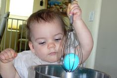 Use a whisk to color Easter eggs with toddlers.
