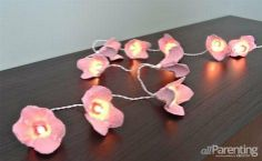 Turn an old egg carton into these beautiful Flower Blossom Fairy Lights #crafts #DIY #eggcarton #recycled #pretty #home #stringlights #flowers
