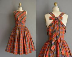 50s open back with a large bow detail vintage dress by Julie Clark.  vibrant paisley print dress. vintage 1950s dress