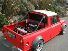 Extreme tuned Classic Mini Cooper pickup with the engine in the back! Awesome <3