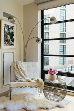 Modern reading nook, Barcelona chair & sheepskin rug | How to Make Your Home Look Expensive on a Budget #theeverygirl